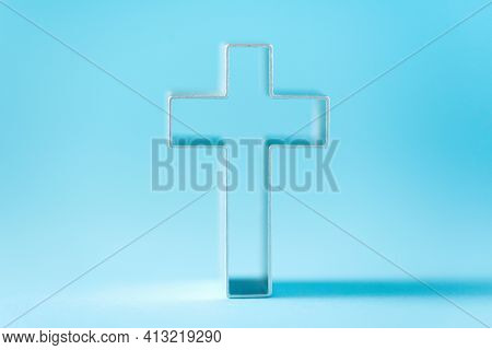 Christian Cross On Blue Background With Soft Bokeh Lights Background. Copy Space. Banner. Church Wor