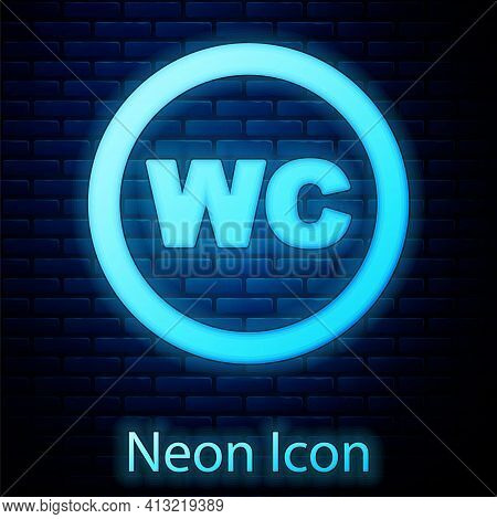 Glowing Neon Toilet Icon Isolated On Brick Wall Background. Wc Sign. Washroom. Vector