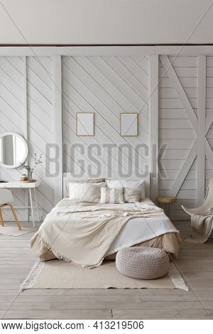 The Bedroom Is Decorated In Soft Light Pastel Colors. A Large Comfortable Double Bed In An Elegant C