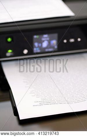 Printed Paper With Lorem Ipsum Text In Modern Inkjet Printer.