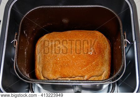 Baked Loaf Of Bread In Electric Bread Maker