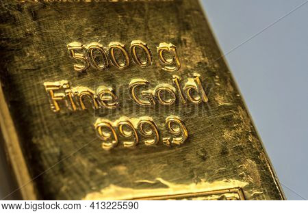 The Surface Of 5000 Grams Gold Bullion. The Texture Of The Surface Of The Gold Bar. Selective Focus.