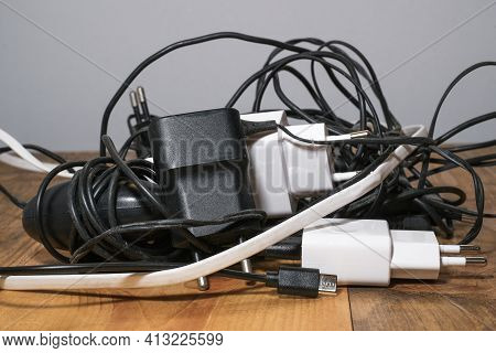 Pile Of Used Smartphone Wired Chargers, Electronic Waste, Tech Device Tools