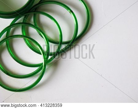 A Group Of Green Color Ladies Traditional Glass Bangles Isolated On White Background