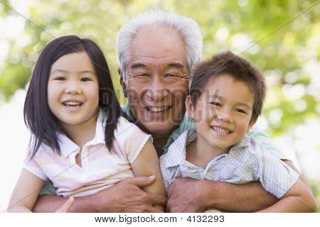 Grandfather Posing With Grandchildren.