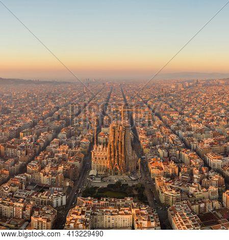 Barcelona, Spain - Feb 25, 2020: Aerial Drone Shot Of Barcelona City Center In Sunrise Glow In Spain