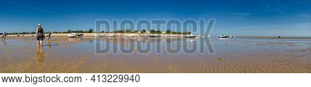 Panorama Of People Looking For Crustaceans At Low Tide In Les Portes-en-ré On The Isle Of Ile De Re