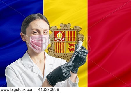 Girl Doctor Prepares Vaccination Against The Background Of The Andorra Flag. Vaccination Concept And