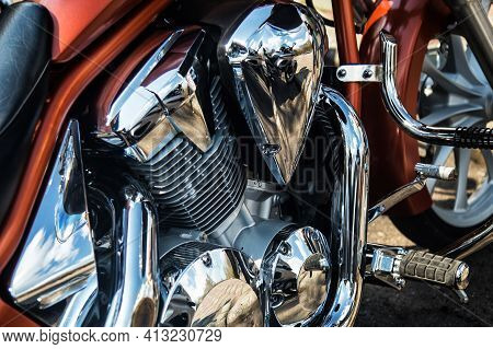 Detail On A Modern Motorcycle In The Workshope. Motorcycle Exhaust. Selective Focus. Closed Up And S