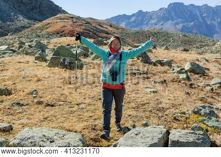Trekking Middle-aged Woman For Healthy Lifestyle Design. Happy Female Tourist With Dslr Camera In Th