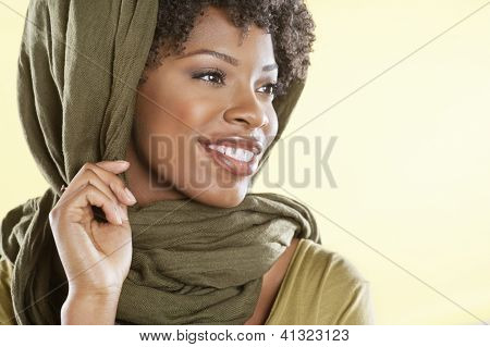 Happy African American woman with a stole over head looking away