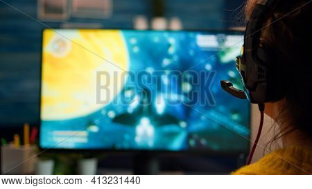 Closeup Back Up Of Woman Portrait Of Professional Gamer Playing Computer Video Game Talking Into Hea