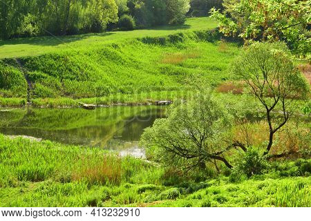 Spring Landscape, Sunrise In The Spring City Park, Green Spring Trees Lit By Light. Bright, Juicy, G