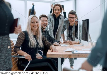 fun group of young employees in the workplace