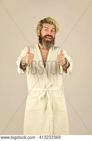 Hygiene And Spa. Man In Bathrobe In Bathroom. Spa Resort. Hotel Apartments. Bearded Guy Wearing Whit