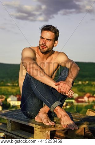 Time To Relax. Macho Man Has Naked Torso. Sexy Man Undressed In Jeans. Male Fashion Model On Sky Bac