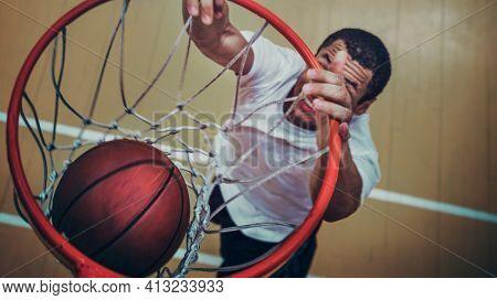 Basketball player making a slam dunk wallpaper