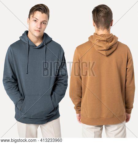 Handsome man wearing hoodie for winter fashion studio shoot