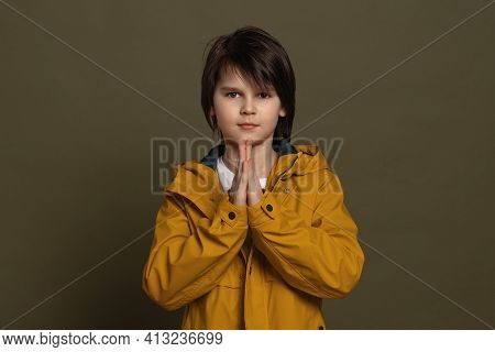 Cute Little Boy 11-13 Years Old Keeps Palms Pressed Together Having Regretful Look, Asking For Forgi