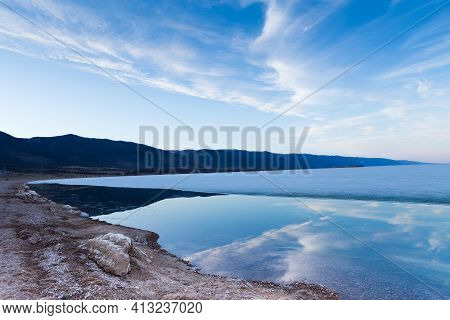 Morning Landscape Of Lake Baikal With Reflaction Of Blue Sky In Pure Water.