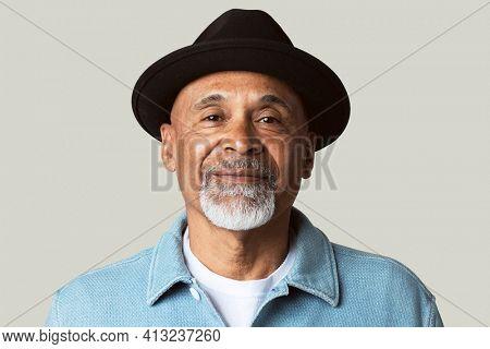 Mature man smiling face closeup portrait on green background