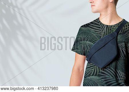 Sporty man with navy belt bag streetwear studio shoot