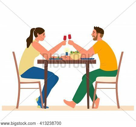 Couple Having Romantic Dinner At Home. Man And Woman Sitting At Table With Snacks Clinking Glasses O