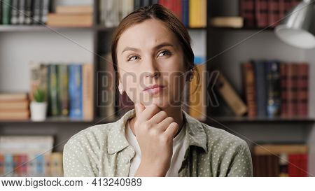 Woman Thinking, Brainstorm, Good Idea Concept. Concentrated Woman In Office Or Room In Apartment Wit