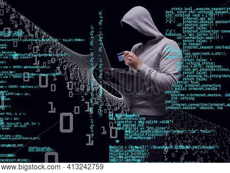Composition of binary coding and data processing over hacker in hood using credit card and laptop. online security cyber attack concept digitally generated image.