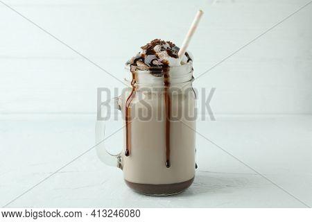 Glass Of Chocolate Milkshake On White Textured Table