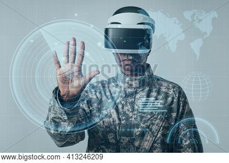Female soldier using futuristic virtual screen army technology