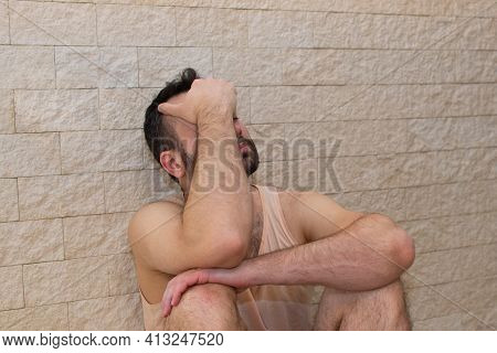 Depressed Young Man Sitting On The Floor With His Head In His Hands. Depression Concept, Panic Attac