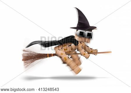Halloween Witch Character Flying On A Broomstick Or Besom With Witches Hat And Cape. Isolated On A W