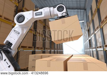 The Robot Arm Picks Up The Cardboard Box In The Warehouse, Automation Robot Arm In The Storehouse. 3
