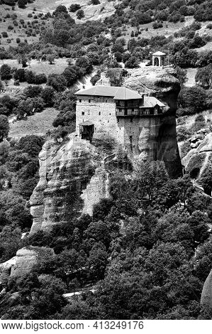 The Orthodox Medieval Monastery On Top Rock Meteora In Greece,monochrome