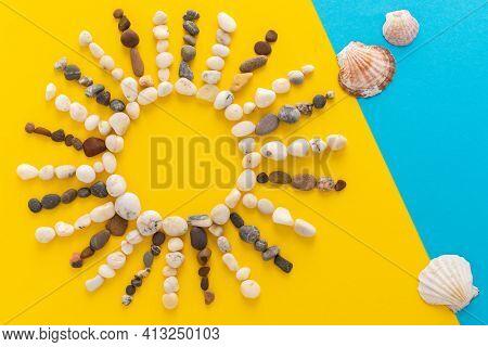 Abstract Sun From Sea Pebbles And Seashells