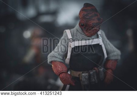 MARCH 8 2021: scene from Star Wars The Mandalorian - character Mon Calamari dock worker on the planet Trask - customized Hasbro action figure