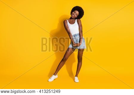 Full Length Body Size View Of Pretty Cheerful Thin Shy Wavy-haired Lady Posing Isolated Over Bright