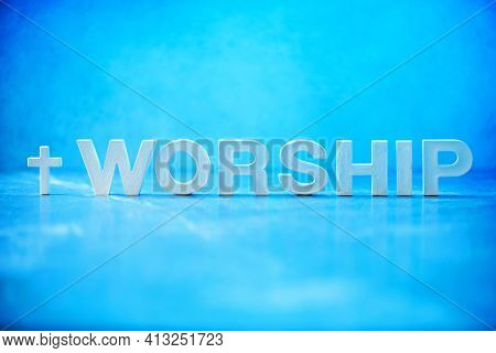 Word Worship Made With Cement Letters On Blue Marble Background. Copy Space. Biblical, Spiritual Or