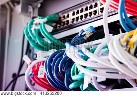 fiber optic cables connected to optic ports, network cables connected to ethernet ports
