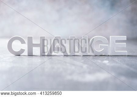 Word Change Word Made With Cement Letters On Grey Marble Background. Copy Space. Concept