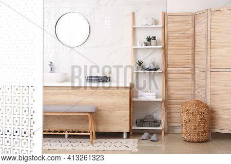 Modern Bathroom Interior With Decorative Ladder Near Countertop