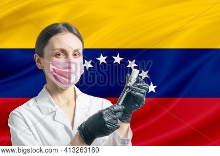 Girl Doctor Prepares Vaccination Against The Background Of The Venezuela Flag. Vaccination Concept V