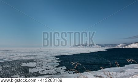 Angara Flows Out Of Lake Baikal Covered With Ice. The Mouth Of The River Does Not Freeze, Ice Floes