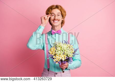 Photo Portrait Of Red Haired Man Smiling Touching Spectacles Giving Flowers On Date Isolated On Past
