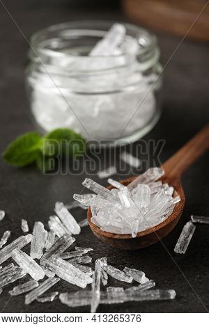 Menthol Crystals In Spoon On Grey Background, Closeup