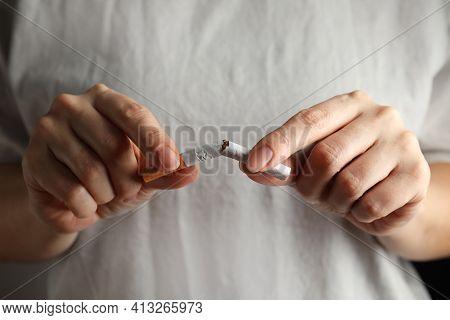 Woman Breaking Cigarette, Closeup. Quitting Smoking Concept