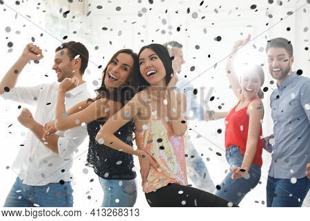 Group Of Happy Friends Dancing At Party