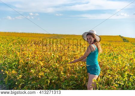 Brazilian Woman Wearing A Hat Propped Up On A Rural Property Fence. Lifestyle. Girl Posing For Photo