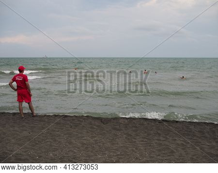 The Lifeguard On The Shore Of The Sea Watching The Bathers In The Storm By Tourists. Georgia, Ureki
